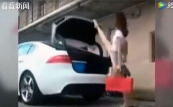สาวจีนฮิตปิดฝากระโปรงรถท่าสุดเท่ (ชมคลิป)