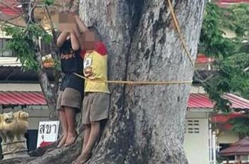 สะเทือนใจ!ภาพเด็กถูกลงโทษ จับขังพืดกับต้นไม้แล้วใช้ไม้ฟาด