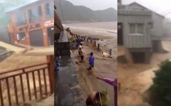 นักท่องเที่ยวกว่า500ชีวิตติดอยู่บนจุดชมวิว\'จีน\' หลังฝนตกหนักน้ำท่วม (ชมคลิป)