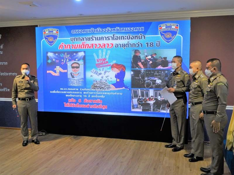 Thai Immigration Police hold a press release regarding the arrests.